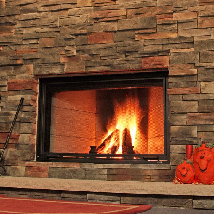 custom stacked stone fireplace installation near racine wi