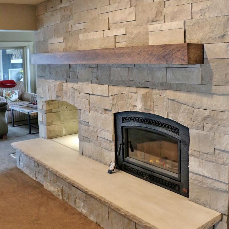 beautiful custom fireplace install with stone facade near kenosha wi